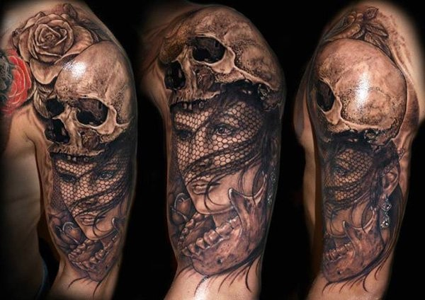 Modern traditional black and white mystical woman with helmet made from human skull tattoo on shoulder with rose