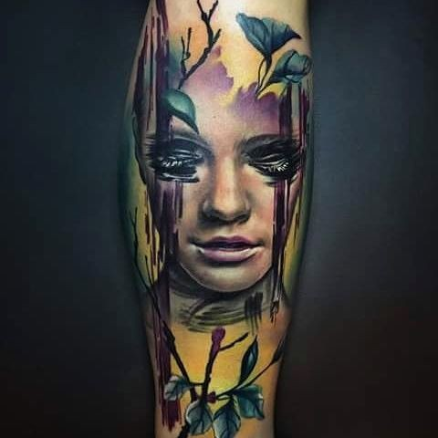 Modern traditional colored arm tattoo of woman portrait with leaves