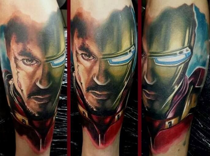 Modern traditional colored shoulder tattoo of Iron man in broken suit
