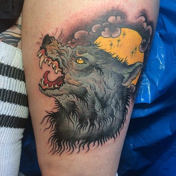 Modern traditional colored thigh tattoo of werewolf with yellow moon