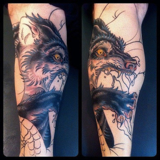 Modern traditional style colored arm tattoo of demonic wolf