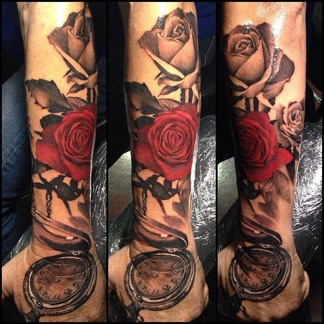 Modern traditional style colored arm tattoo of roses with vintage clock