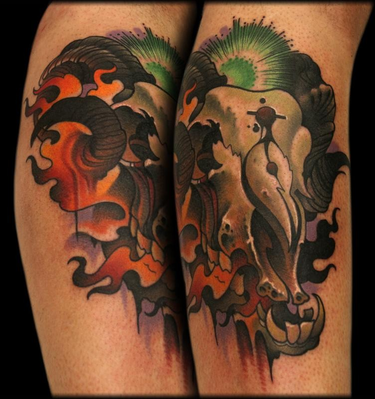 Modern traditional style colored arm tattoo of goat skull with flames
