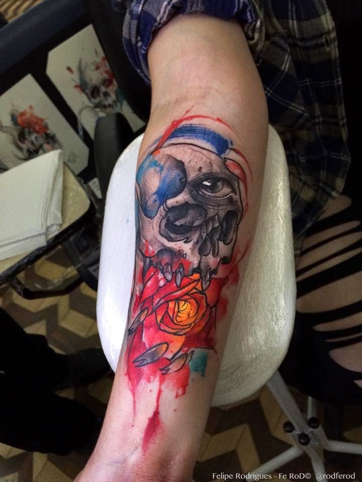 Modern traditional style colored arm tattoo of human skull with flowers