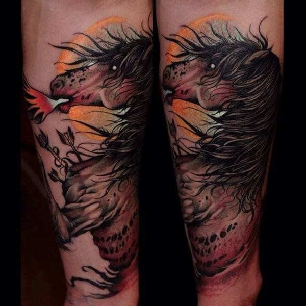 Modern traditional style colored forearm tattoo of horse with arrows