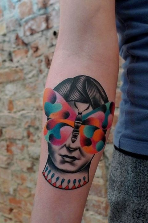 Modern traditional style colored forearm tattoo of woman head and butterfly