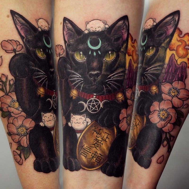 Modern traditional style colored forearm tattoo of maneki neko japanese lucky cat with golden tablet