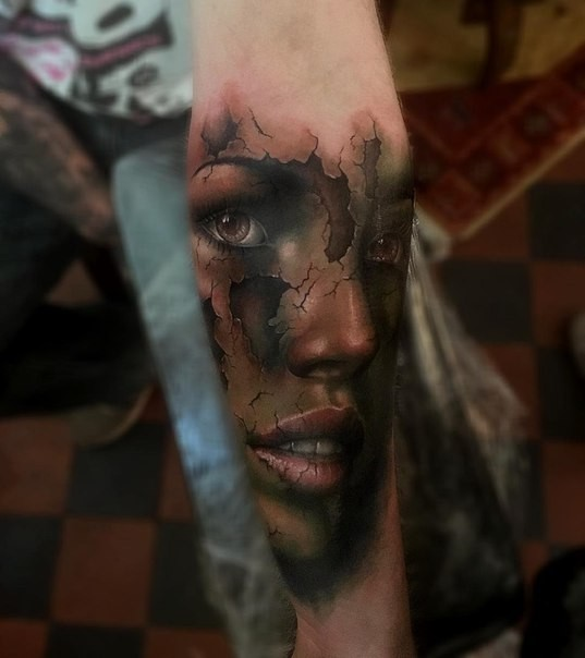 Modern traditional style colored forearm tattoo of corrupted woman face