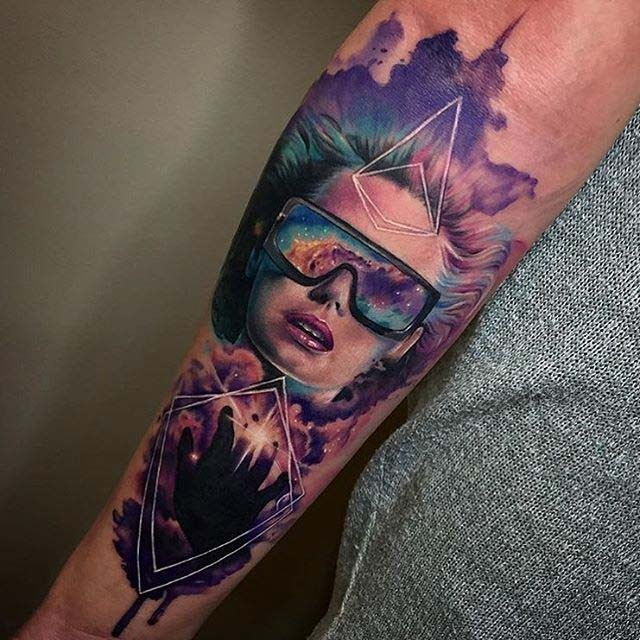 Modern traditional style colored forearm tattoo of modern woman with space