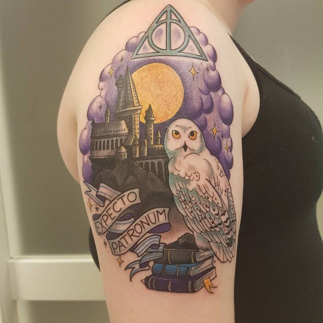modern traditional style colored harry potter movie themed tattoo on shoulder with lettering. Black Bedroom Furniture Sets. Home Design Ideas