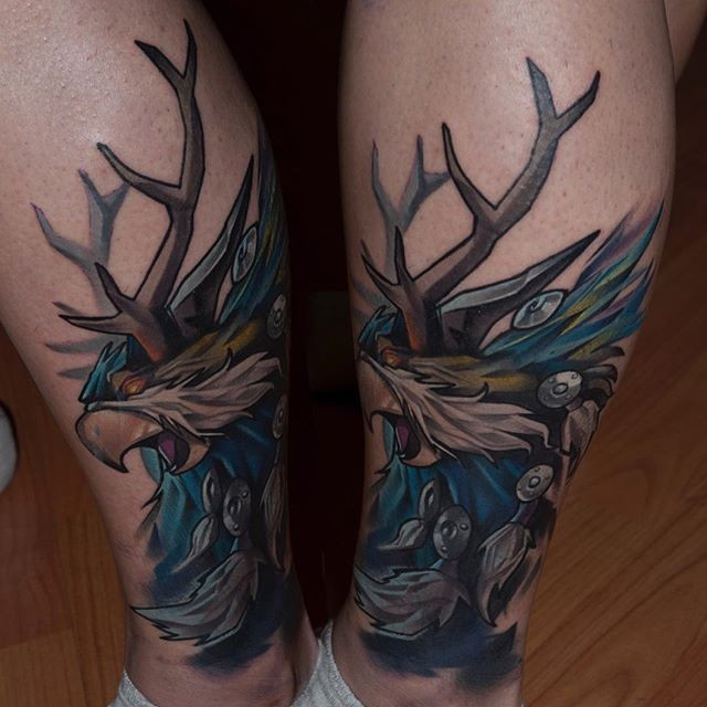 Modern traditional style colored leg tattoo of mystical demonic creature