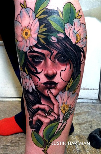 Modern traditional style colored leg tattoo of cute woman with flowers