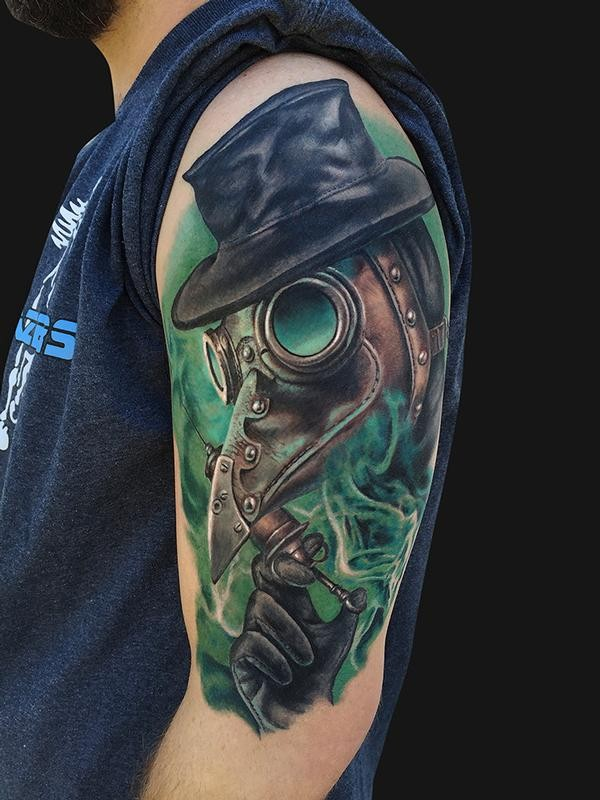 Modern traditional style colored shoulder tattoo of fantasy man with mask and green fox