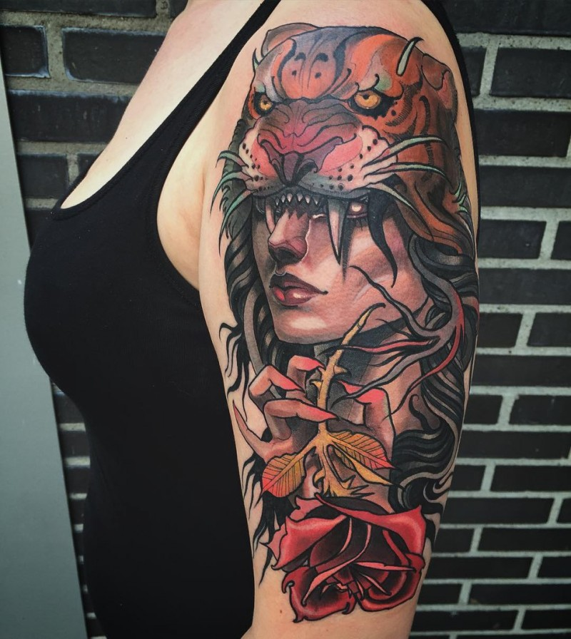 Modern traditional style colored shoulder tattoo of woman portrait with helmet made from tiger skin