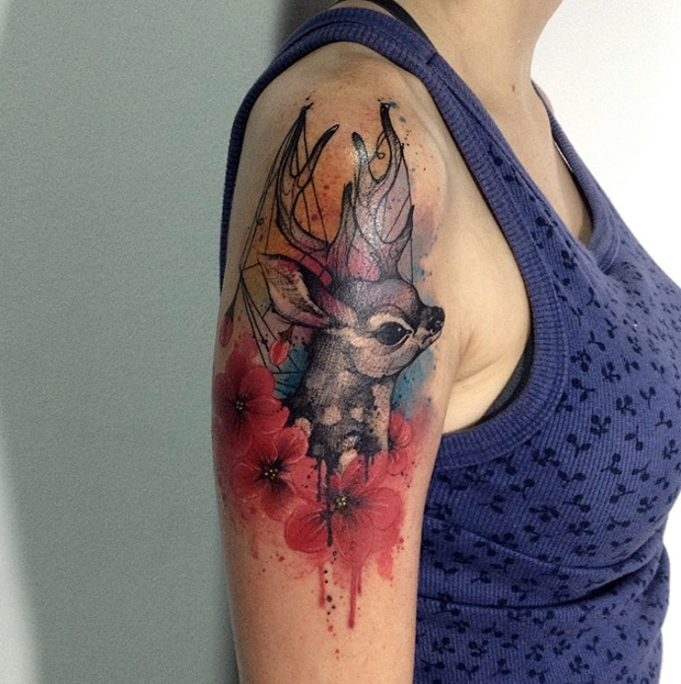Modern traditional style colored shoulder tattoo of small deer with flowers
