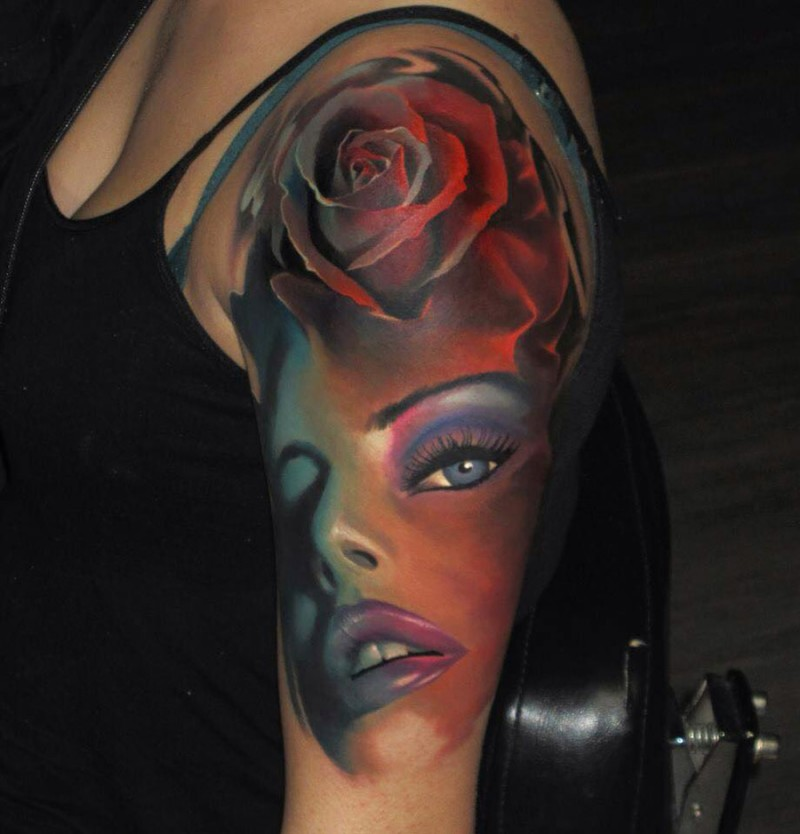 Modern traditional style colored shoulder tattoo of woman face with rose