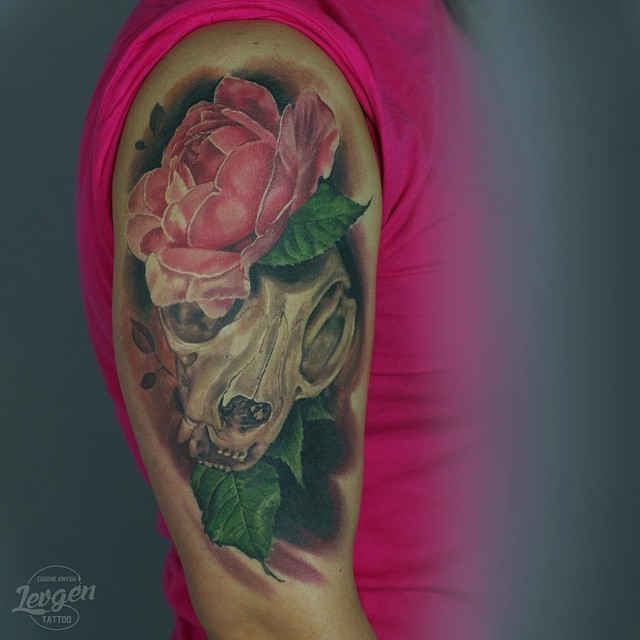 Modern traditional style colored shoulder tattoo of cat skull with flower