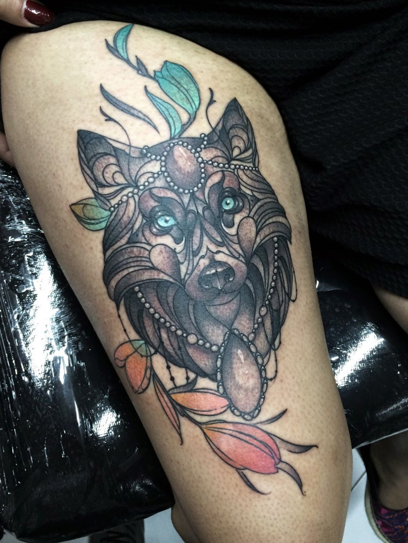 Modern traditional style colored thigh tattoo of wolf with jewelry and flowers