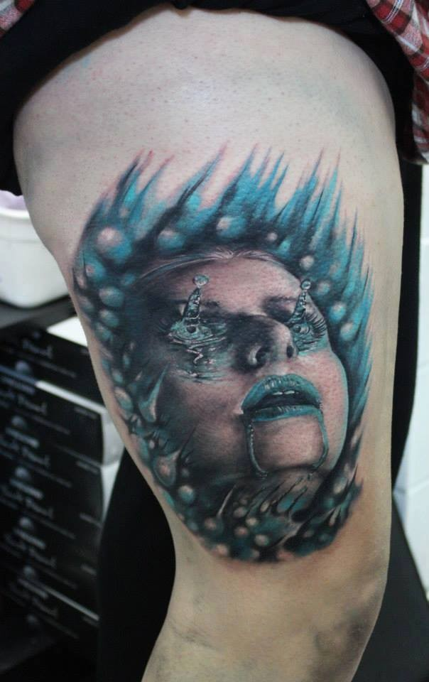 Modern traditional style colored thigh tattoo of drowned woman face