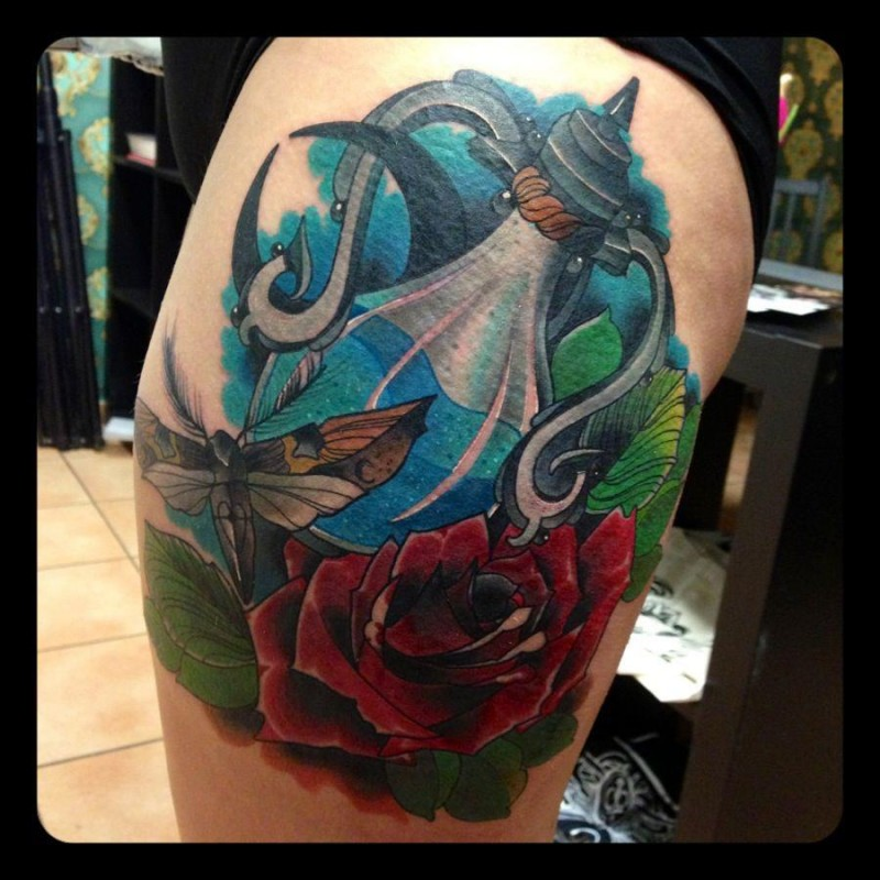 Modern traditional style colored thigh tattoo of magical pot with roses and butterfly