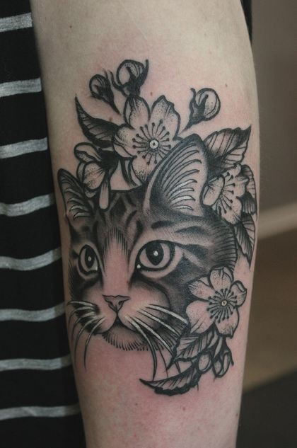 Modern traditional style detailed arm tattoo of cat with various flowers
