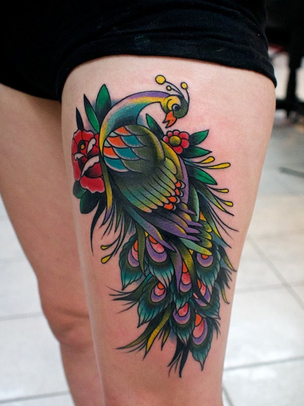 Multicolored peacock and red rose flower thigh tattoo in old school style