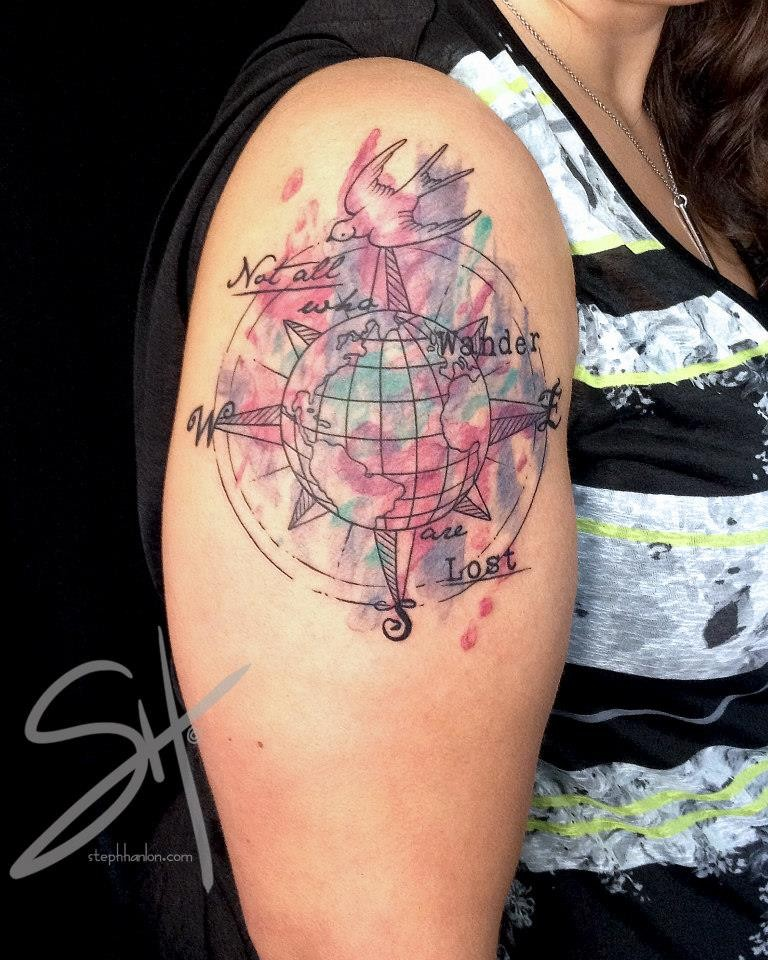 Multicolored shoulder tattoo of globe with lettering