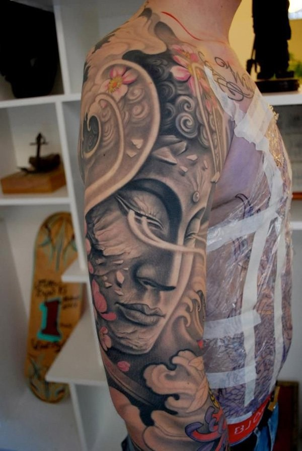 Multicolored sleeve tattoo of Buddha statue and flowers