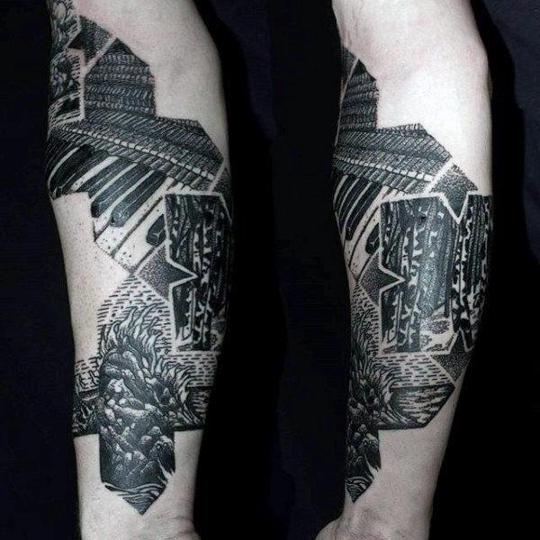 Tatuaggio con braccio di inchiostro nero a tema musicale