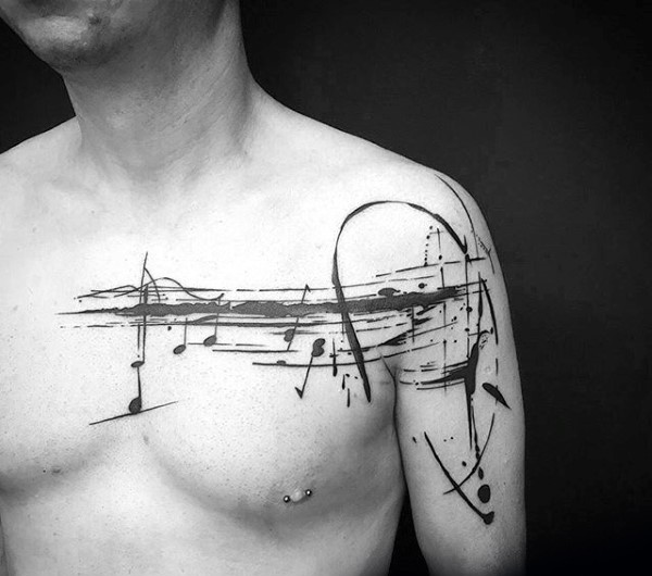 Music themed black ink collarbone tattoo of notes