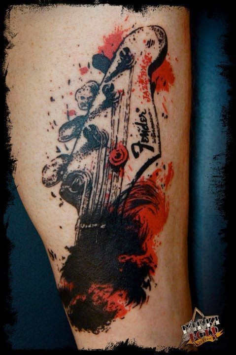 Music themed little colored abstract tattoo on leg