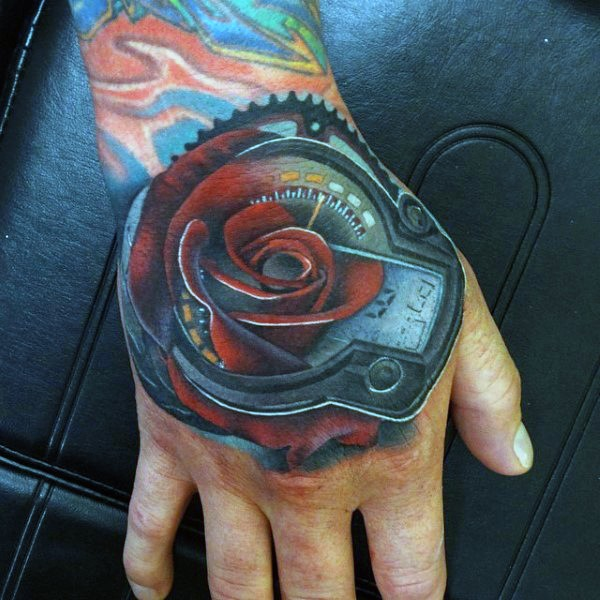 Music themed little flower shaped colored tattoo on hand