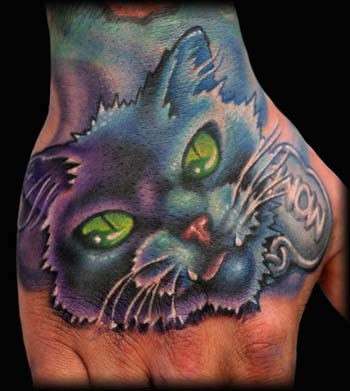 Muzzle a cat tattoo on hand
