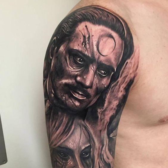 Mysterious black and gray style man with moon symbol tattoo on shoulder