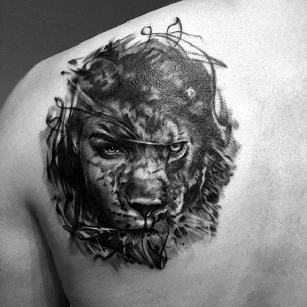 Mysterious black and white shoulder tattoo of half lion half woman face