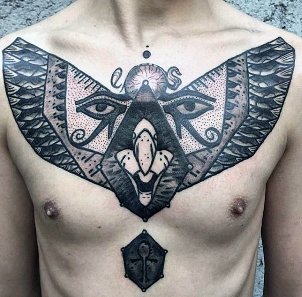 Mysterious black ink chest tattoo of big mask with eyes