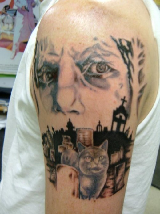 Mysterious colored cat in cemetery tattoo on shoulder stylized with man portrait