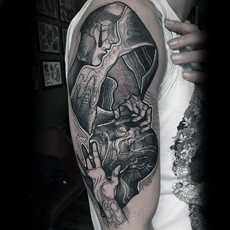 Mysterious designed black and white big tattoo on shoulder