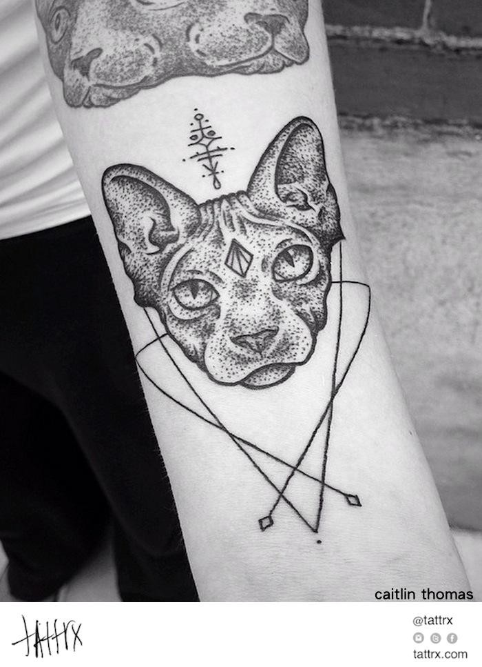 Mysterious dot style arm tattoo of cat head with cult ornaments