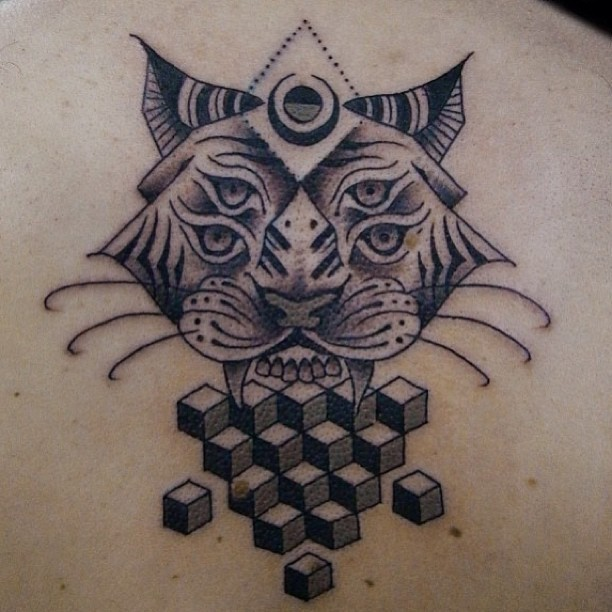 Mysterious half dot half geometrical style back tattoo of demonic cat with geometrical figures