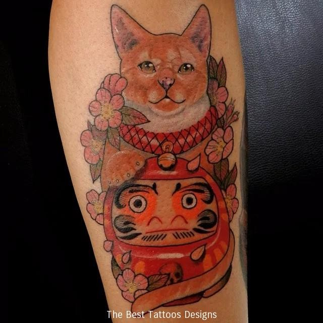 Mysterious old school style arm tattoo of maneki neko japanese lucky cat with doll and flowers
