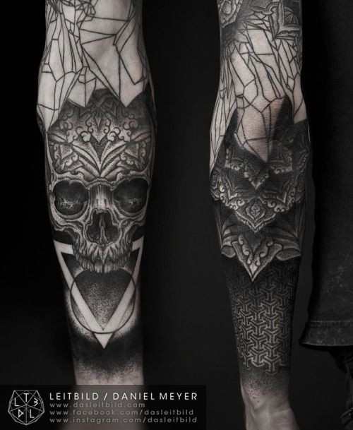 Mysterious style painted black ink skull with flowers glass like tattoo on sleeve