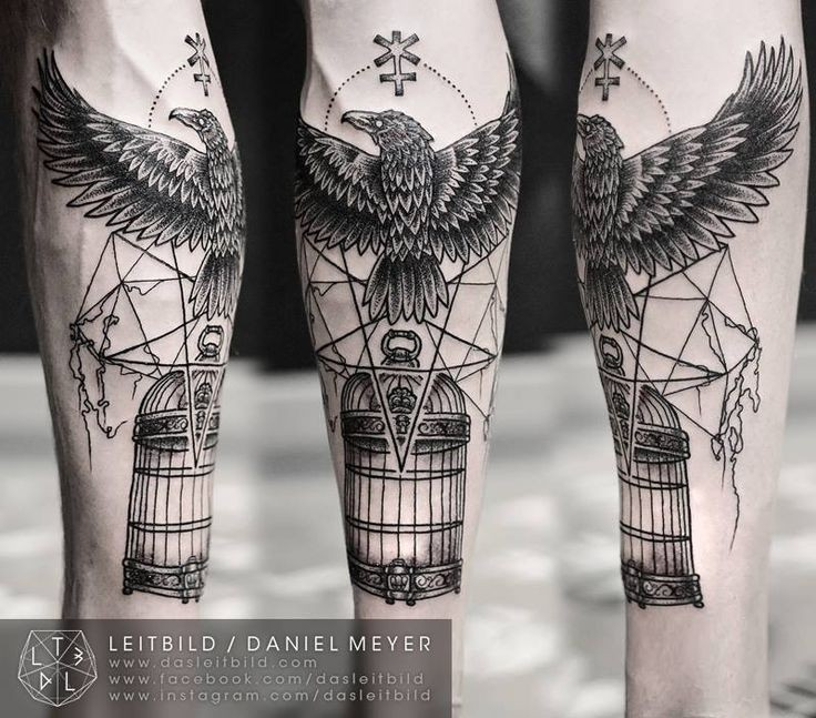 Mystical black and white big crow with cage and symbols tattoo on arm