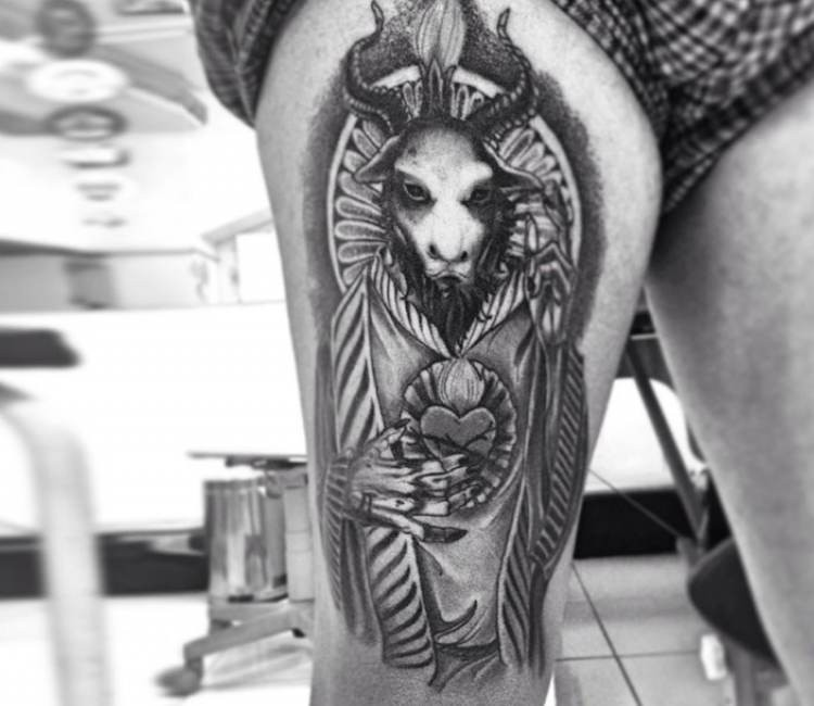 Mystical black and white detailed demonic goat tattoo on thigh