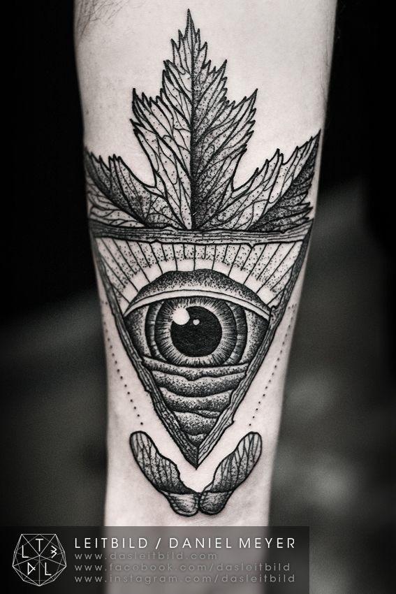 Mystical black and white Masonic pyramid tattoo on arm