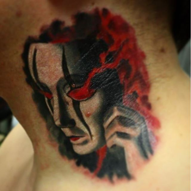 Mystical black and white neck tattoo of demonic mask