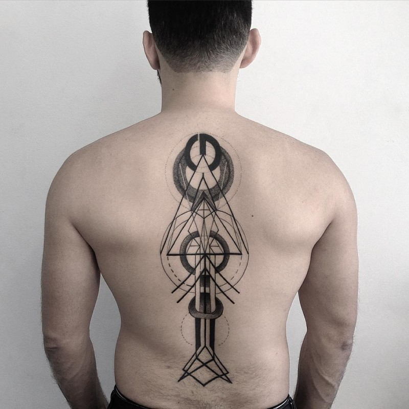 Mystical black ink back tattoo of alien like ornaments