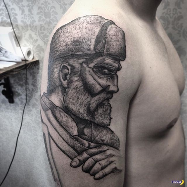 Mystical black ink detailed interesting looking shoulder tattoo of man portrait
