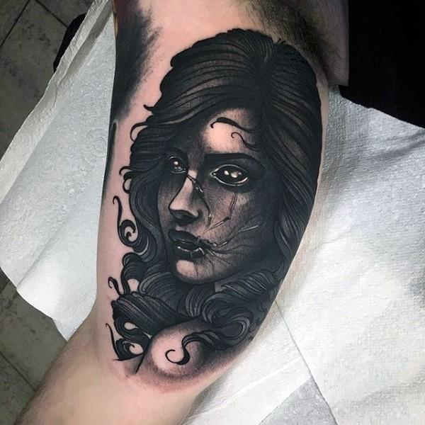 Mystical black ink engraving style biceps tattoo of demonic woman portrait