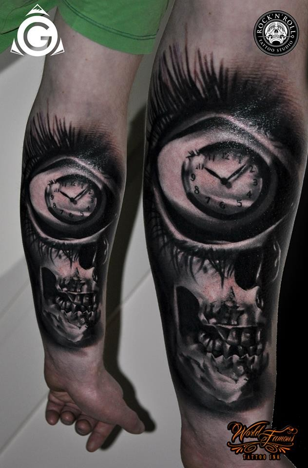 Mystical black ink forearm tattoo of human skull with clock